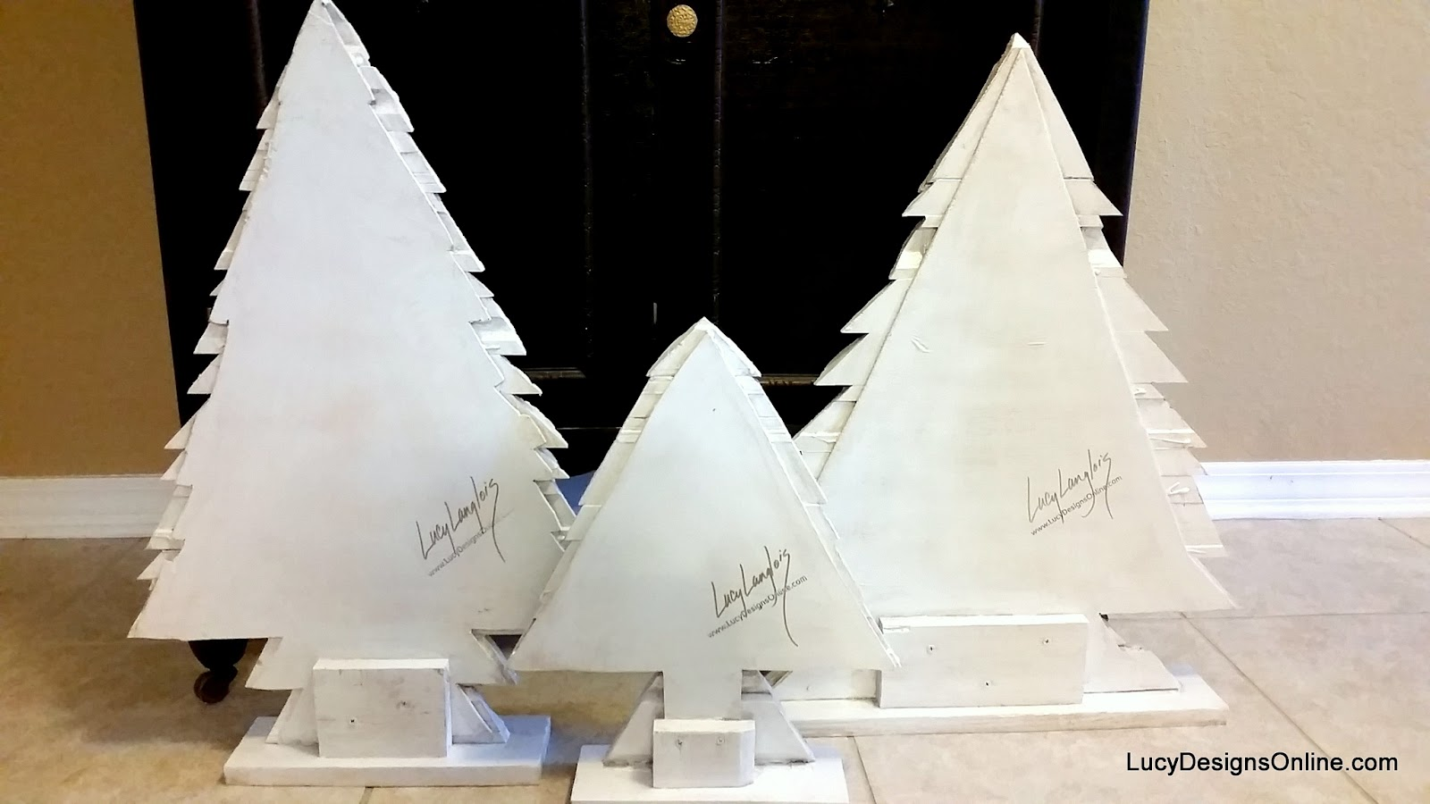 Christmas tree sculptures in distressed white