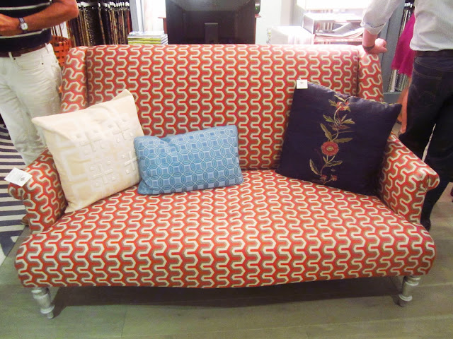 Orange, white and brown graphic printed settee