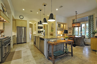 a wide kitchen area for easy movement is furnished with stainless steel and gorgeous granite counter top, while further by the window is the dining