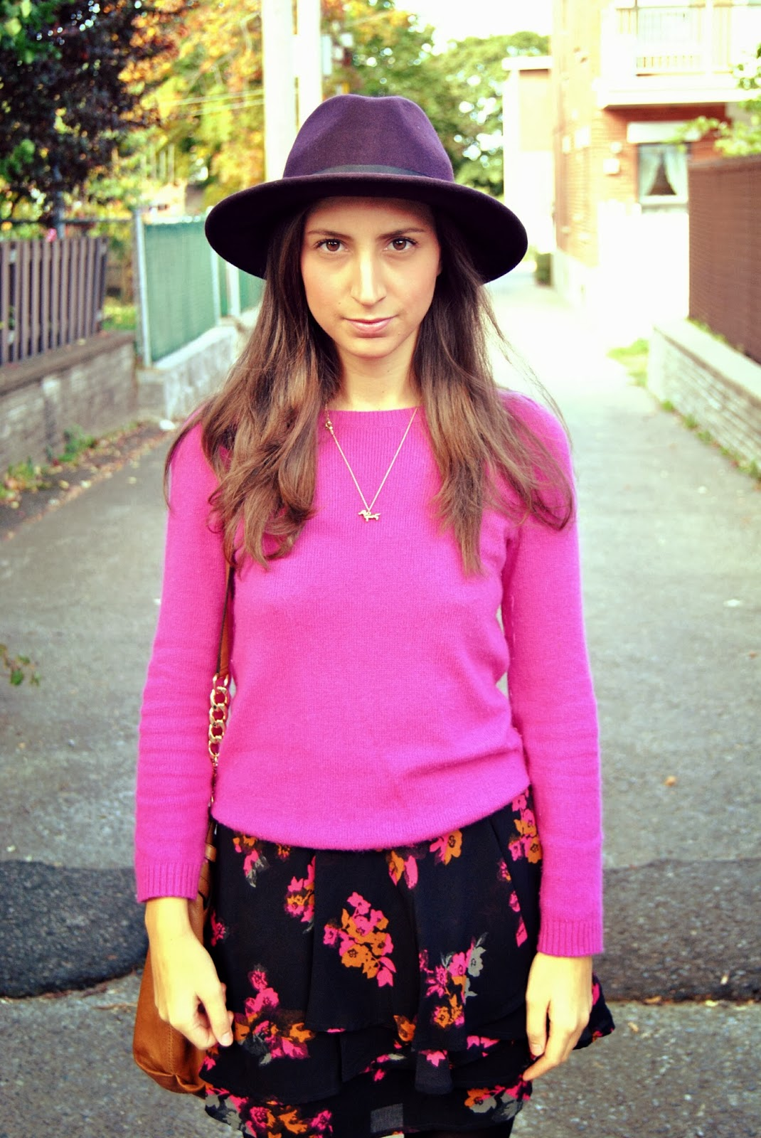 purple hat pink sweater floral skirt
