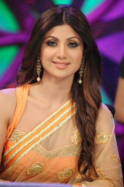 Shilpa Shetty in a Orange designer Blouse with Open front in Indian saree