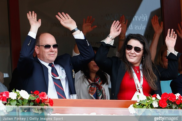Albert II, Prince of Monaco and Melanie-Antoinette de Massy taking part in the mexican wave during day seven of the Monte Carlo Rolex Masters tennis at the Monte-Carlo Sporting Club