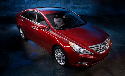 Front 3/4 view from above of red 2011 Hyundai Sonata