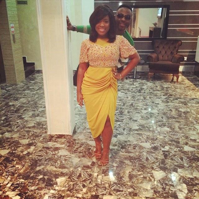 Moet Abebe Wearing a Yellow Virgos Lounge Dress