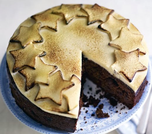 Mincemeat Christmas Cake: A quick Christmas cake made with a mincemeat base that tastes like a rich fruit cake, but which only requires a few days to mature, shown topped with toasted marzipan (almond paste).