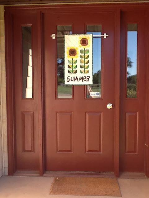 Here it is on the front door. My family prefers narrow door banners so we can still see out the windows and see who is there. My front door is metal ... & Tanya Quilts in CO: Summer Sunflower Banner