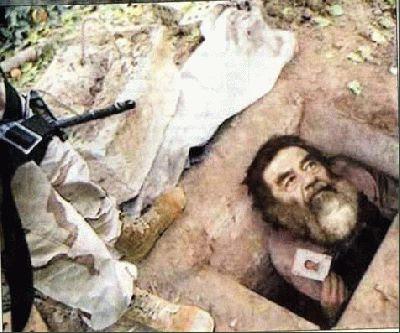 هل تم إلقاء القبض على صدام حسين وهو داخل حفرة ؟