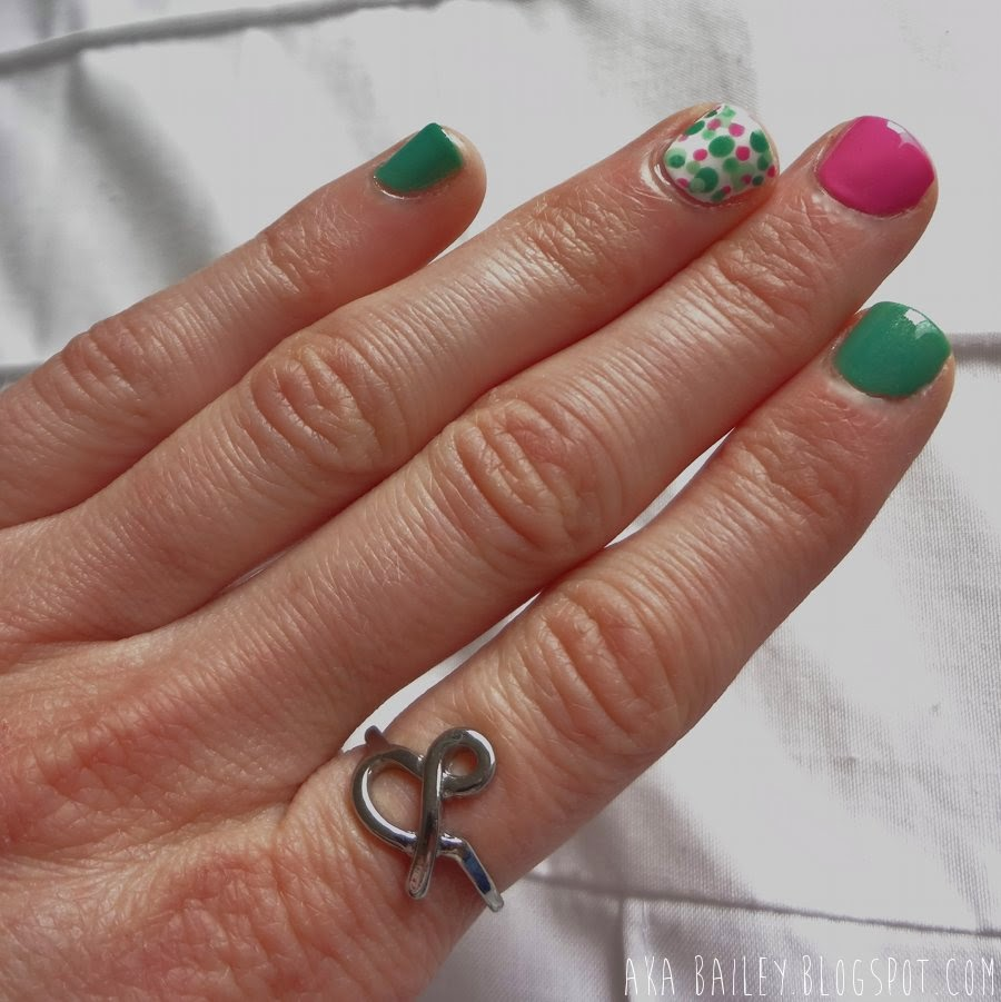 Mint Apple nails with Tip Toe Pink and polka dot accent nails, ampersand ring