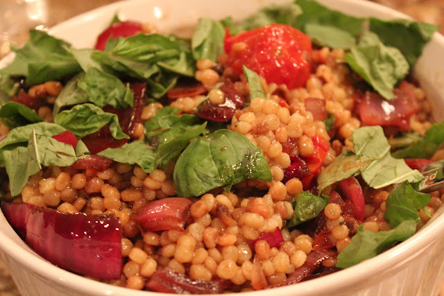 Fregola with charred onions and roasted cocktail tomatoes