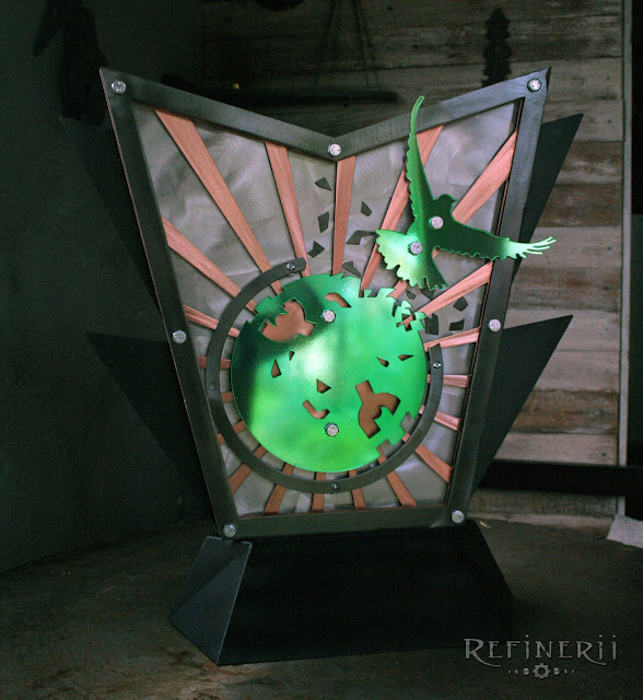 metal trophy with green accents