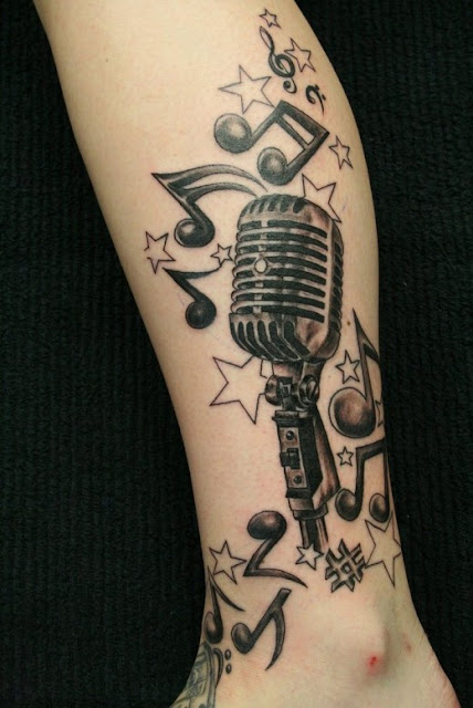 Tattoos Designs Music. musical tattoo designs.