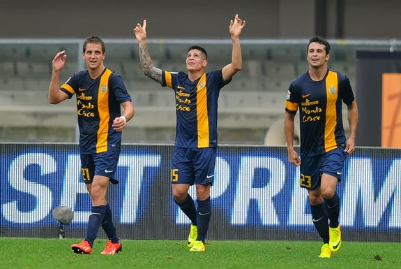 Verona player Juan Iturbe celebrates after scoring the opening goal against Livorno