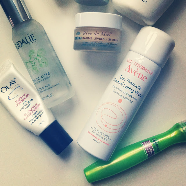 beauty, skincare, Caudalie Beauty Elixir, Nuxe Reve de Miel Lip Balm, Avene Thermal Spring Water, Garnier Anti-Puff Eye Roller, Olay Touch of Concealer Eye Regenerating Cream