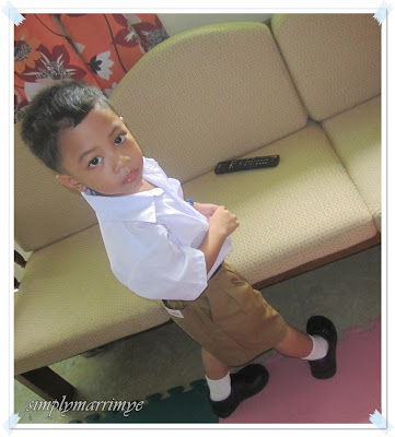kiko with his first ever school uniform