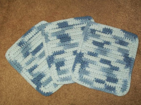 http://www.shophandmade.com/Item/Cotton-Crocheted-Washcloths-Set-Of-3-In-Billowing-Blues-from-Marsha-s-Spot/H81PF49