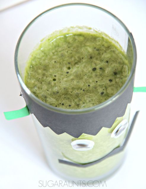 Frankenstein cup craft and green smoothie recipe for a fun Halloween snack for kids. Make these at a Halloween party for a healthy alternative to sweet drinks!