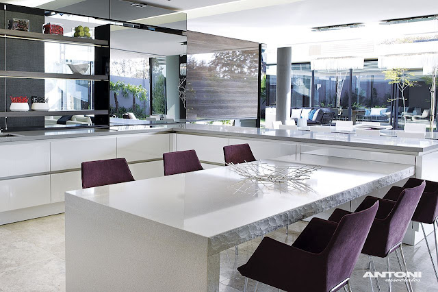 Picture of modern kitchen interiors with purple chairs in the South African dream home