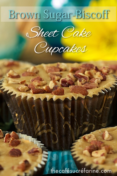 Closeup photo of a Brown Sugar Biscoff Sheet Cake Cupcake with other cupcakes in the foreground and background.