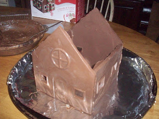 After making two sets of roof, side and front pieces, 'glue' the side walls to the front pieces with more melted chocolate.