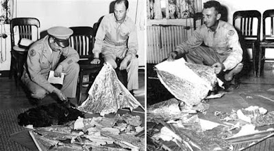 investigators examing roswell crash debris