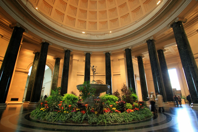 Another beautiful fountain is decorated with flowers and pillars at National Gallery of Art in Washington DC, USA