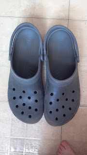 pair of gray crocs