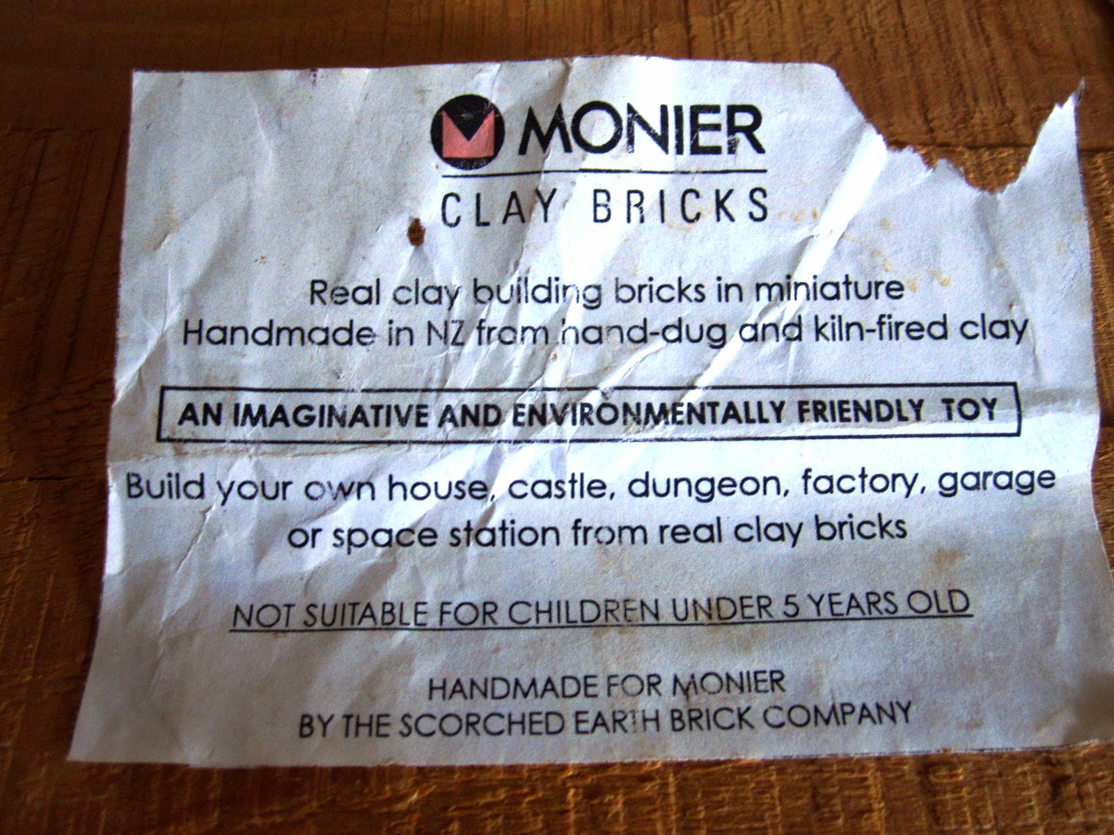 Paper label on the top of a box of miniature Monier clay bricks.