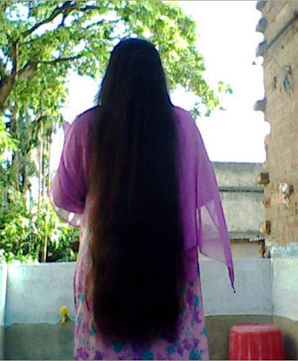 Traditional keralite girl with long hair wearing saree.