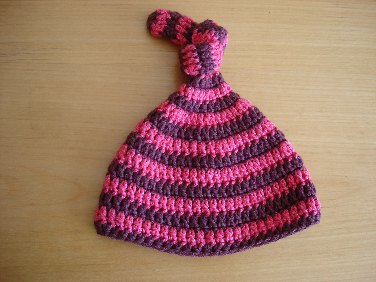 Free Crochet Pattern For Baby Leprechaun Hat : Is it a toy: Topknot stripes baby hat