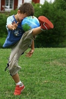 funny picture child hits the ball completely wrong