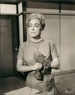 Joan Crawford one glove on, one glove off photograph