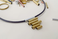 http://www.makery.uk/2015/11/diy-pendant-from-brass-tube-offcuts/