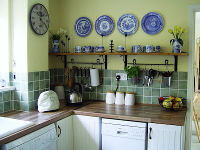 Mike and Rosie's white, green and yellow kitchen with pops of blue.