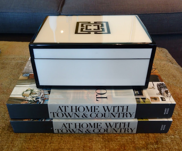 COCOCOZY Lacquer box sits on a stack of two At Home with Town and Country books