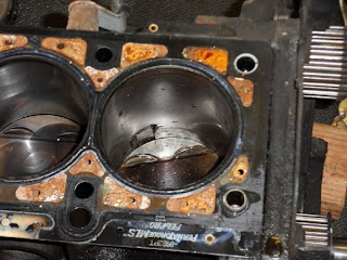 badly mangled piston in our race car engine