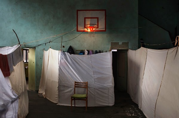 refugee center in bulgaria, just a sheet for privacy
