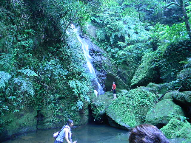 People Playing at the waterfall