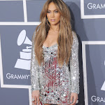 Jennifer Lopez Hot Legs and Cleavage Show At The 53rd  Annual Grammy Awards