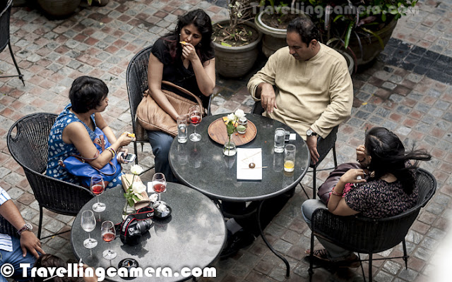 In continuation to photographs shared from recent Four Seasons event at Cheri One Qutub, here are few more photographs of some of the amazing Delhi Bloggers... Check out this Photo Journey and know more about it...Here is a photograph of Mr. Arvind Passey, one of the most popular Indian Bloggers who is almost everywhere when it comes to blogging. It was great to meet him last weekend, although I have participated in one of the online blogging event as his team-mate.  Check out http://passey.info/ to know more about him.Here is a photograph of The Chef who demoed all snacks for the evening which were served with various kinds of wines at Cheri One Qutub, Delhi... Raman has joined Cheri three months back after working with many of the multinational brands in India and abroad...Ekta, who was very concerned about demoing non-veg things only... which was quite valid concern and probably should be considered by Four Seasons folks... But I loved the fact that both the items were non-veg during evening :) ... although there were other snacks as well ! Ekta's blog can be checked at - http://ektakhetan.blogspot.com/Here are three other cheerful bloggers at Cheri, posing with white roses in their hands... Aishwarya, Akanksha & Priyanka. To know more about them check out following -Aishwarya - http://aishwaryaeats.blogspot.comAkanksha - http://expressionssss.blogspot.comPriyanka - http://www.priyankazneverland.blogspot.comThe trend of blogger meets is increasing as this is considered as one of the best marketing strategies by big companies. And the good part is that every organization knows that, it's something different style of marketing and they plan it in very professional way. Of course, these events are a good chance for bloggers to meet and discuss some relevant stuff... Although during this event, I could interact with one set of bloggers - specifically Delhi Sutra group Pan Seared Scallops with Four Seasons Wine !It was great to see bloggers posing for me :) ... Some of the bloggers had seen my photographs and they liked... Usually I don't click posed photographs, but it also another challenge that comes to you without any lead time to get ready... Hope that both of them like this one !Arvind Passey with his interesting expressions and quick one liners... He was carrying Samsung Galaxy S3 and clicked lot of photographs from this event.. Some of the Moile clicks by him can be checked at - https://www.facebook.com/media/set/?set=a.10152057462215416.895466.623230415&type=3It was time for next live cooking session.. so let's have some red wine and move closer to the chef Raman !Abhay Kewadkar telling about Wine trends in India and more about Baramati project of Four Seasons Wines !Although I am not happy with this photograph but wanted to share because this is only photograph of Deeba Rajpal. She is a wonderful food blog with very good visual sense. Just check out her Food blog with wonderful clicks at http://www.passionateaboutbaking.com/#wine was trending at Cheri One Qutub during Sunday evening..All relevant details on the Four Seasons Wines are available @ http://www.fourseasonsvineyards.com/.Have a look at few of the blog posts from our previous events @ http://www.fourseasonsvineyards.com/blogFor details on Cheri One Qutub @ https://www.facebook.com/cheriatonequtu...