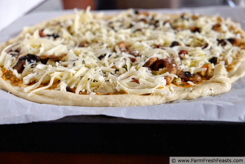 Fresh Tomato Pesto with Mushroom, Olive, Artichoke and Feta Pizza  | Farm Fresh Feasts