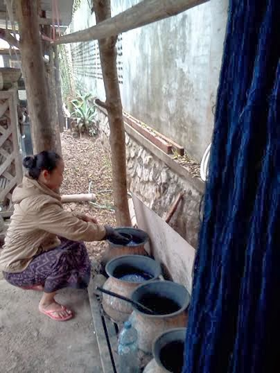 Dying fabric indigo in Laos.