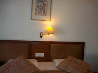 yellow lamp queen size bed hotel, India, Interior design, Peanut butter color bed cover, white pilllow cover