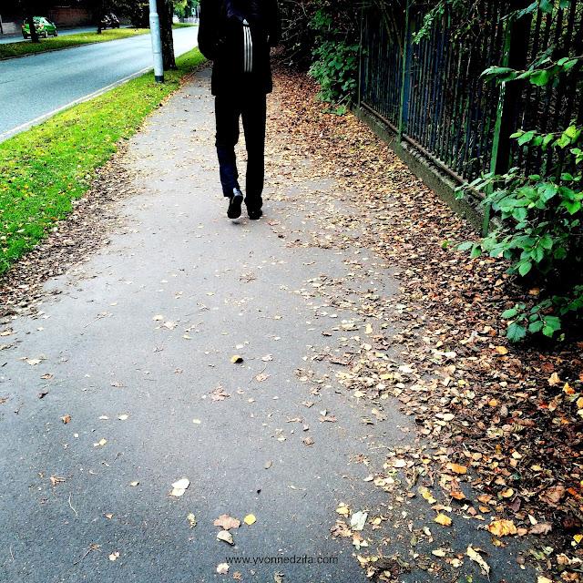 lovely husband amongst autumn leaves