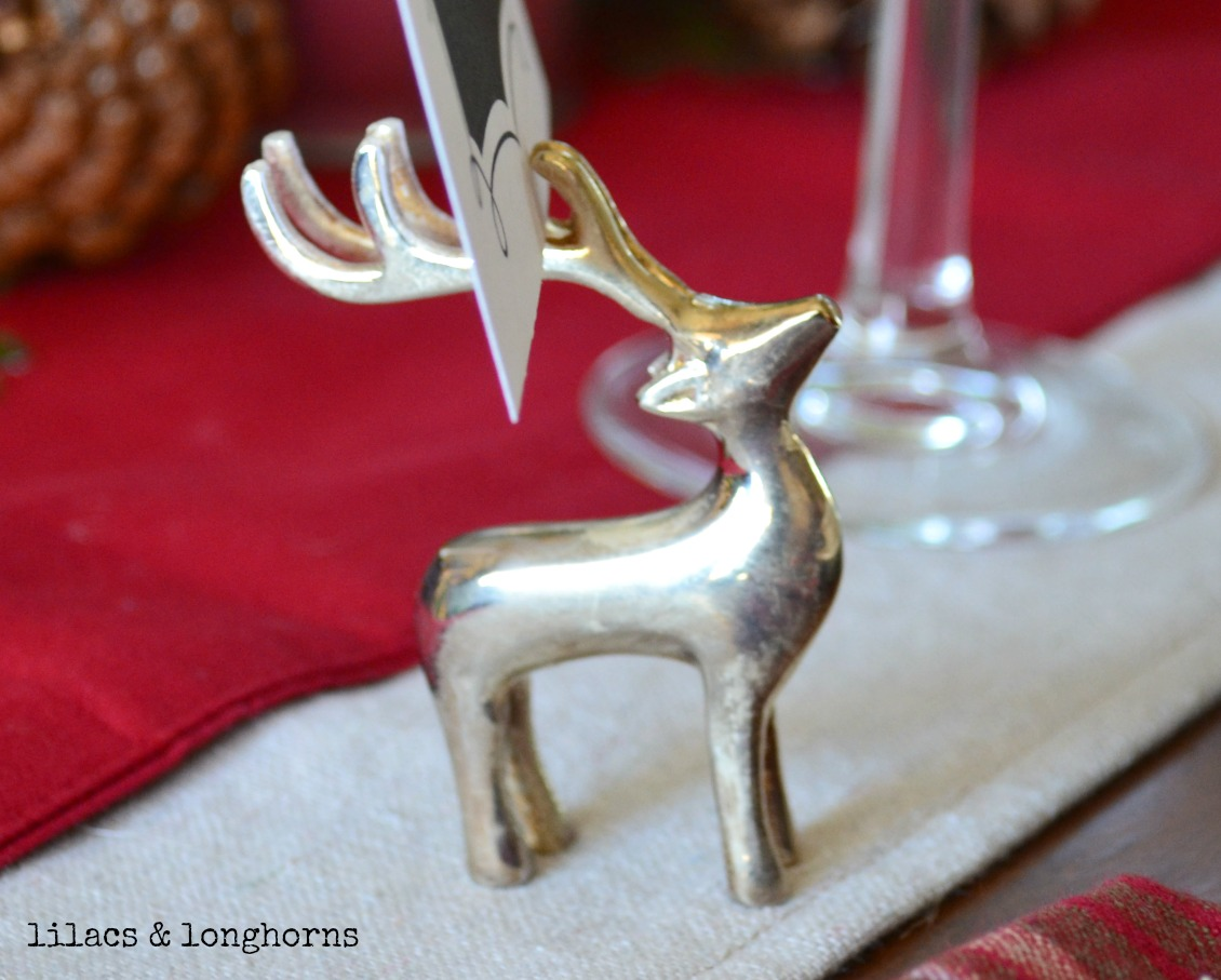 my friendly little pottery barn reindeer place card holders are proudly holding them i found these shortly after i got married and i still love them