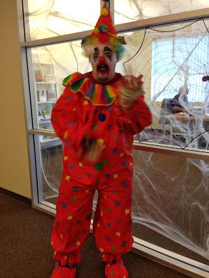 GotPrint employee in clown Halloween costume juggling balls 2013
