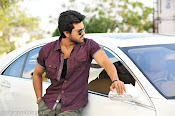 Ram Charan Rocking Photos from Racha Telugu Movie-thumbnail-10