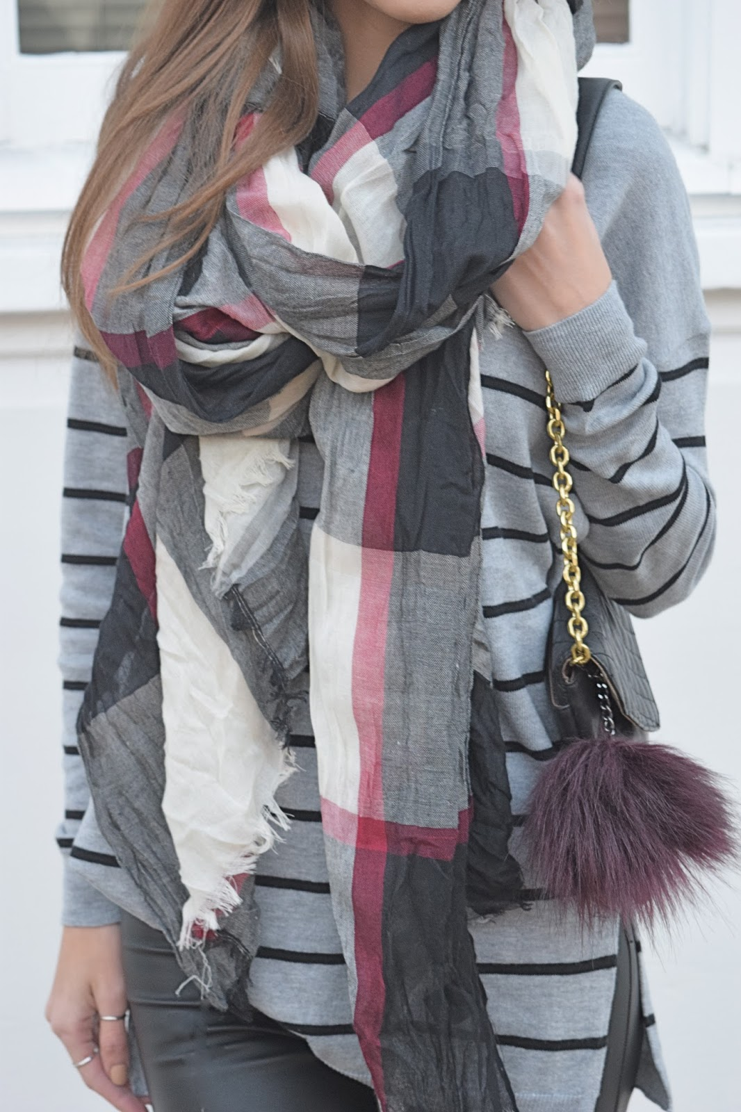 Wearing Old Navy Tunic Striped Sweater. Striped Sweater, Plaid Scarg, Fur keychain on Purse