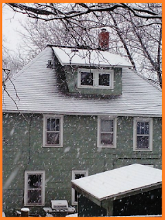 large amounts of snow falling - green house as a backdrop