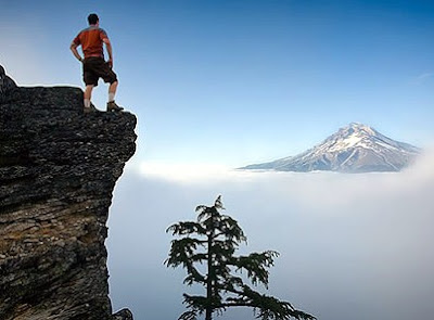 man on mountain, a spectacular view, party with the gods, qratio.net