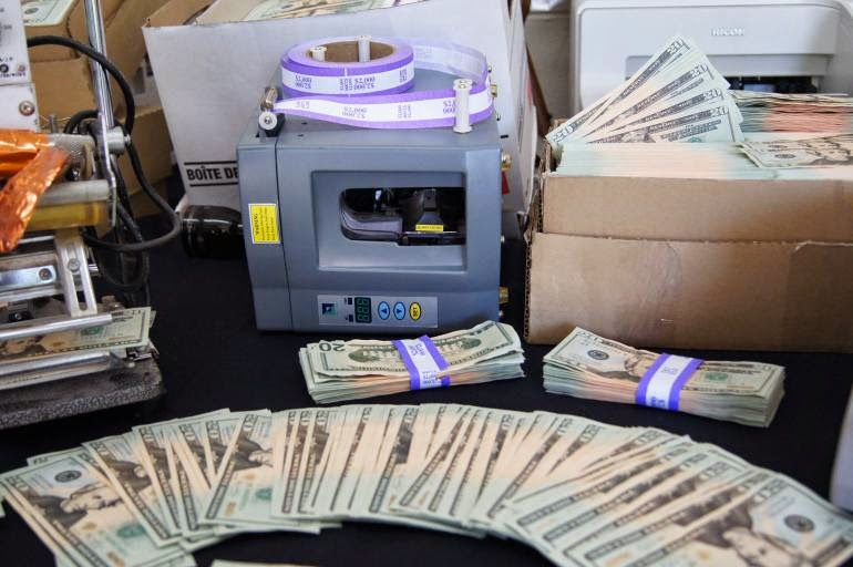 paper for printing counterfeit money Later that evening agents snuck up to the building and peered through its windows, spotting a film processor, paper cutters, a printer, and other supplies that suggested the construction of a .